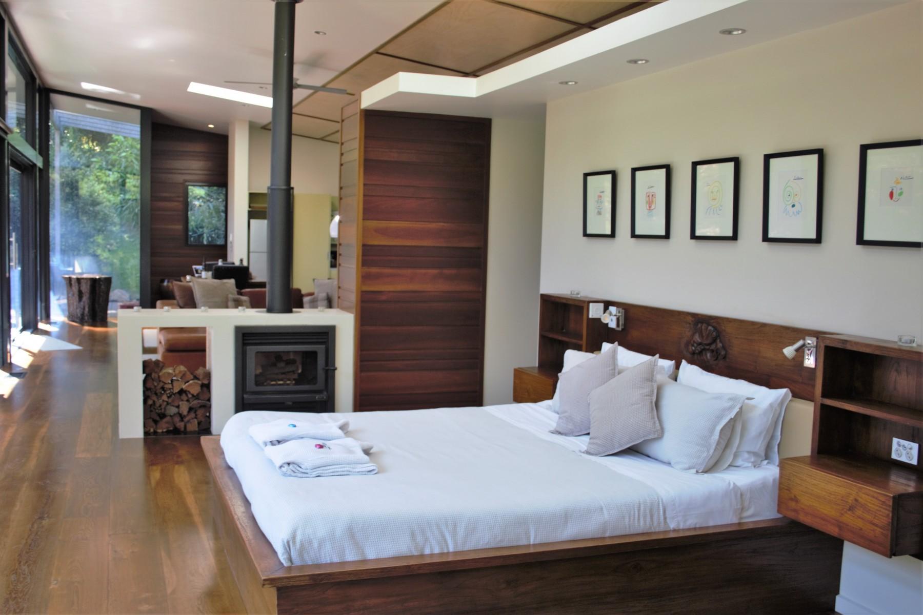 Crystal-Creek-Rainforest-Retreat-Lamington-Lodge-Bedroom-Fireplace.-Image-Kate-Webster